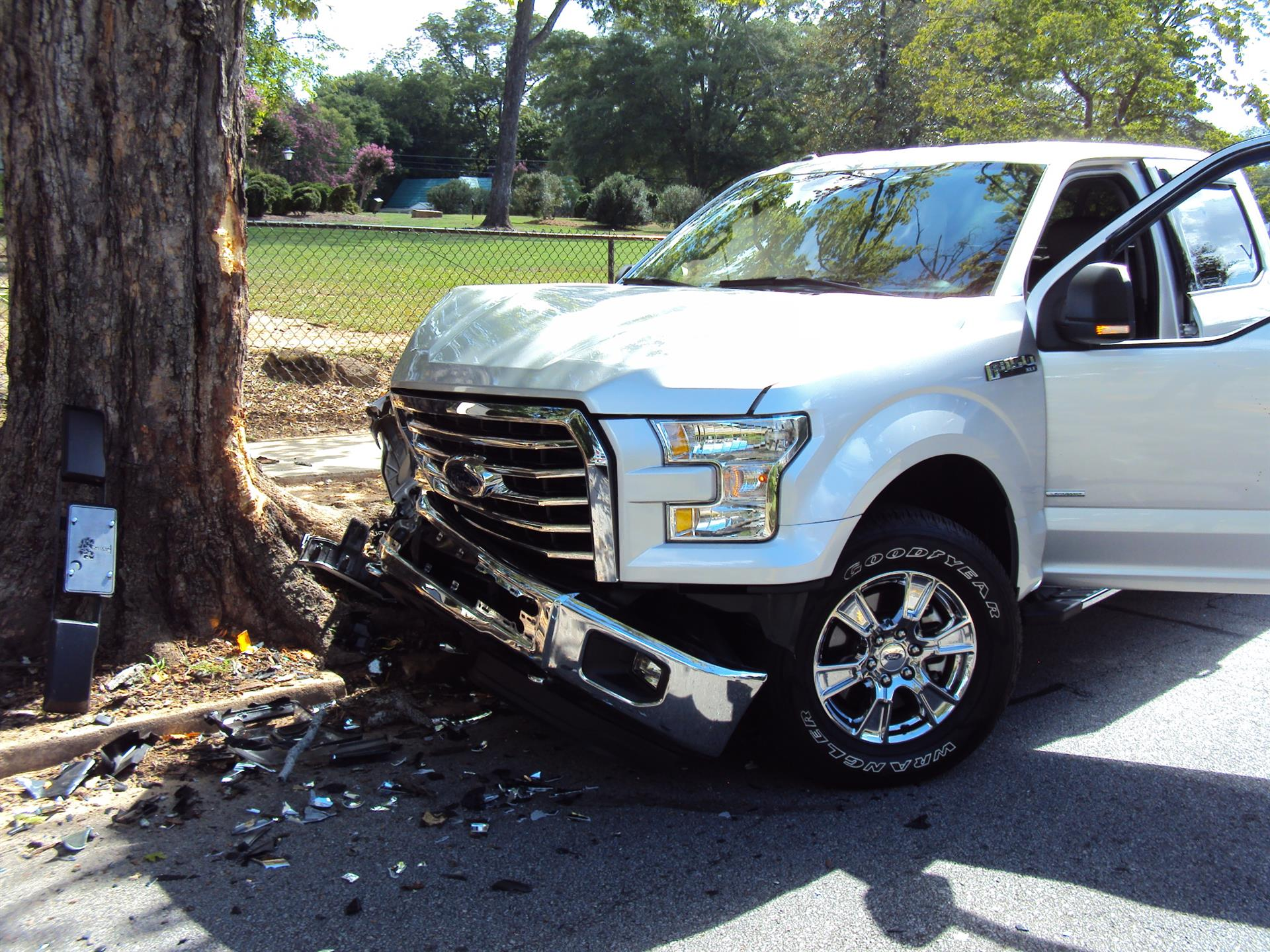 Truck crashed against tree with broken front bumper