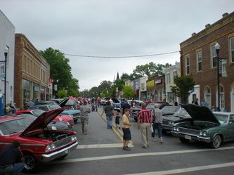Wide shot of cars at car show