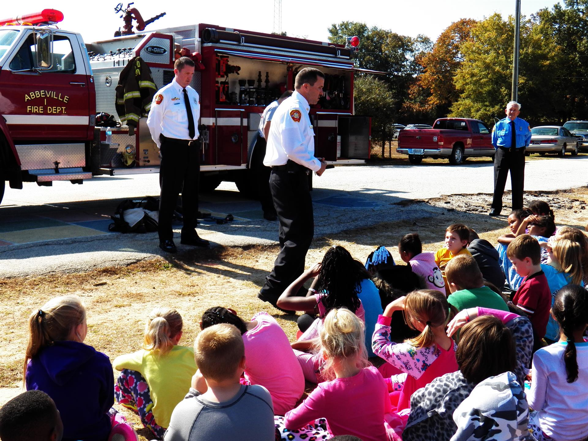 Firefighters talk to children