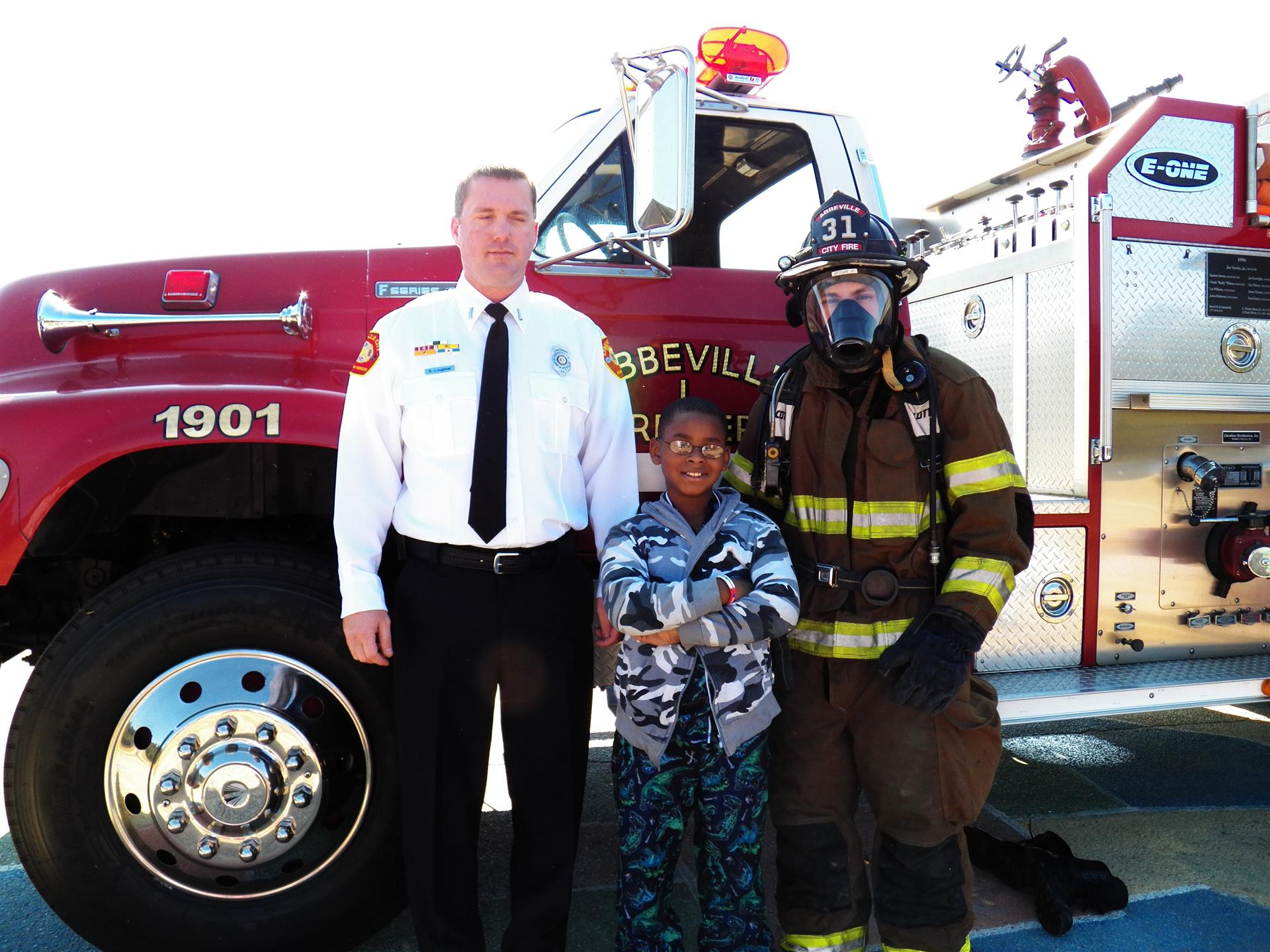 Firefighters with child